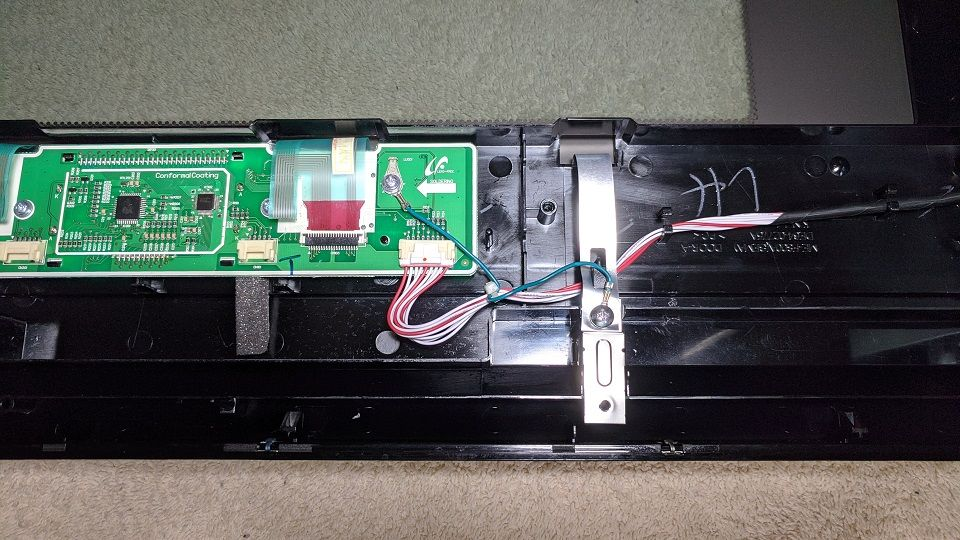 Circuit board as found inside door before fix. Note green grounding wire.